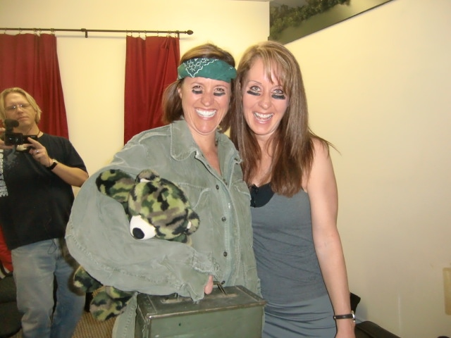 Robyn smiling with a person