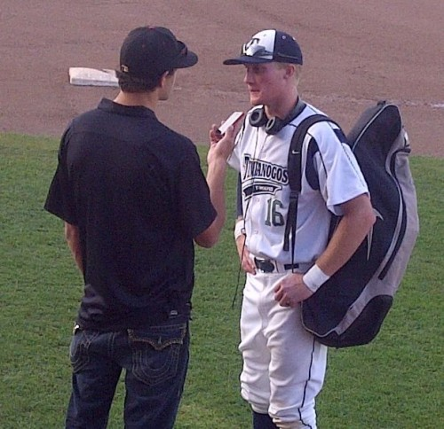 being interviewed by newspaper reporter after grand slam state finals