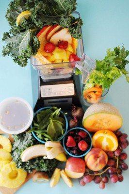 Blender, greens, and fruit