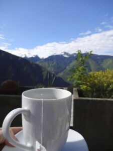 Cup of tea with Swiss Mountains in background