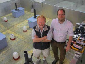 James Ruff and professor Wayne Potts stand inside a semi natural mouse enclosure at the University of Utah in Salt Lake City
