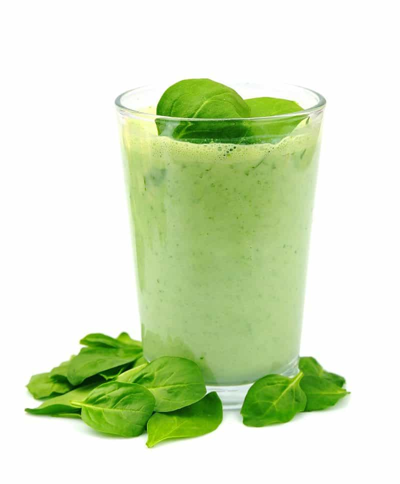 Green smoothie with spinach garnish