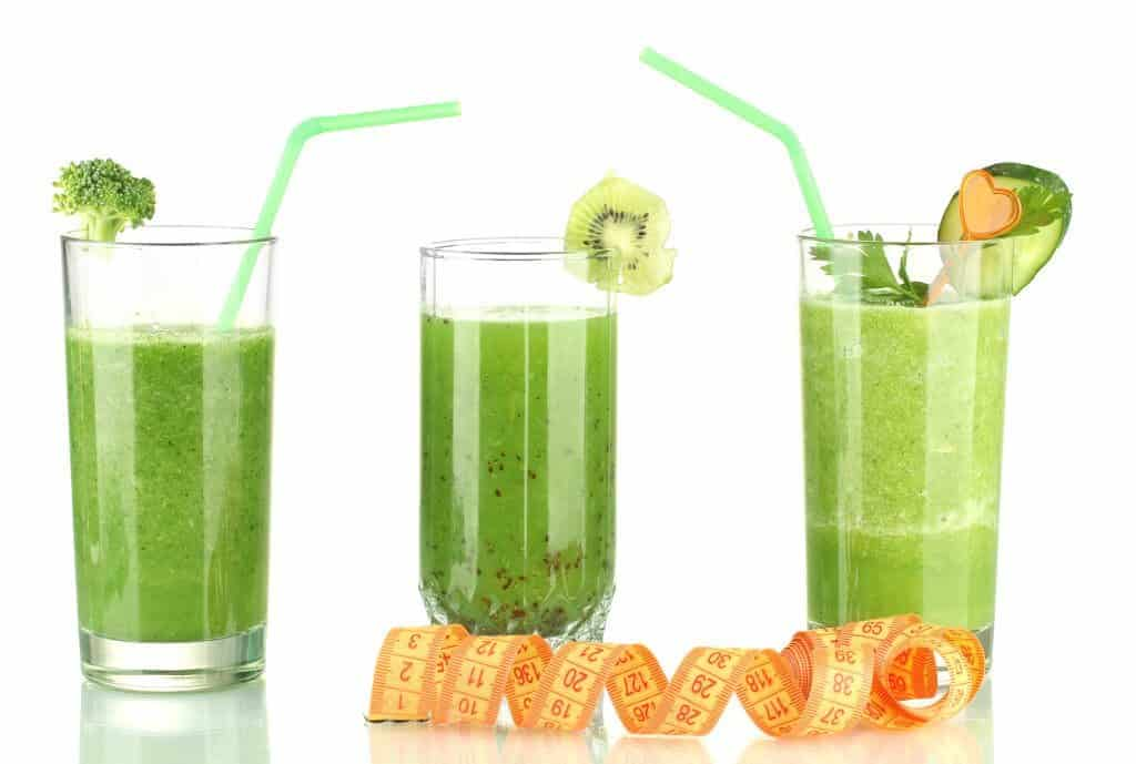 3 green smoothies and a waist tape measure