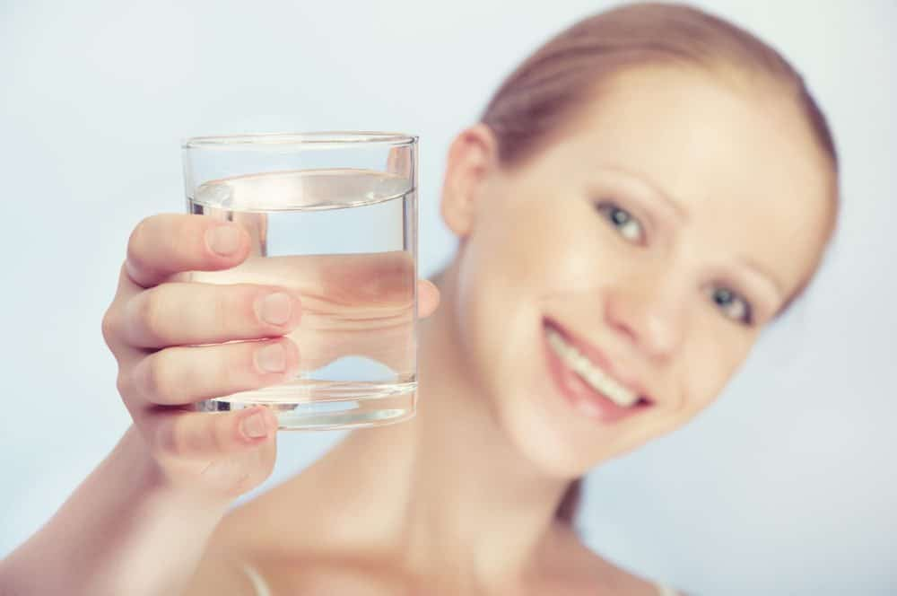 woman with glass of clean water