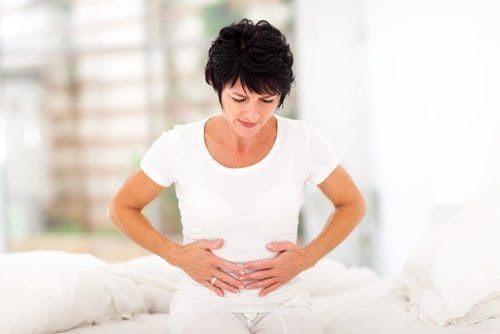 woman suffering with pain from digestive issues