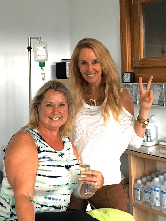 Robyn and happy lady enjoy wine