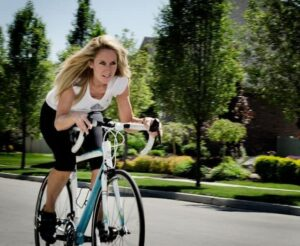 Robyn cycling to improve her health