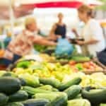 "Photo of organic produce at open space market from ""Is Buying Organic Food Always Necessary?"" by Green Smoothie Girl"