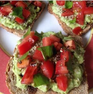 Photo of avocado and tomato toast with flaxseed from