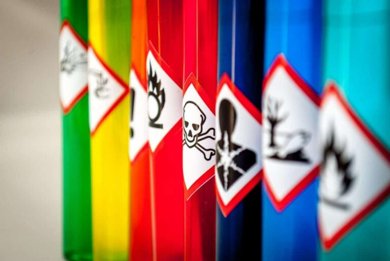 """Photo of colorful tubes with toxic warning labels on them from """"{VIDEO} Could Toxicity Be Why I'm Sick? (7 Types of Toxins In Your Body)"""" by Green Smoothie Girl"""