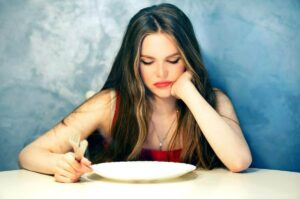 "Photo of bored woman staring at empty plate from ""{VIDEO} How to Change Your Weight ""Set Point"" Forever"" by Green Smoothie Girl"