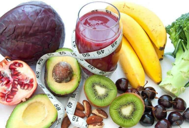 """Photo of fruit surrounding pink smoothie with soft measuring tape entwined from """"{VIDEO} How to Change Your Weight """"Set Point"""" Forever"""" by Green Smoothie Girl"""