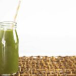 "Photo of green smoothie in glass with straw from ""Does Everything that Goes in Your Mouth Have to Taste Good?"" by Green Smoothie Girl"