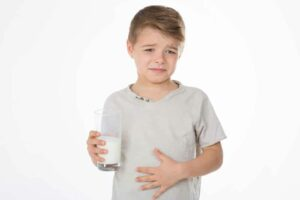 Don't Get Your Calcium From Milk--a young boy reacting badly to milk