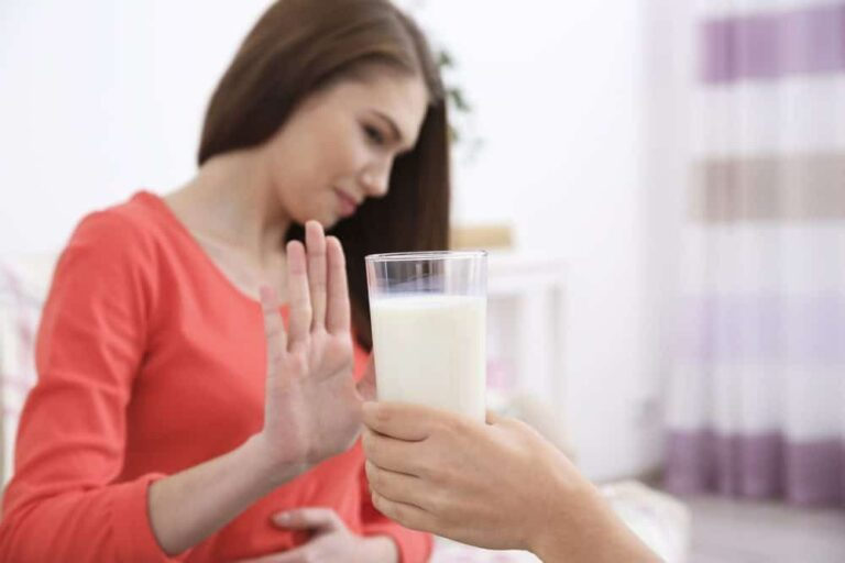 Young woman refusing to drink milk