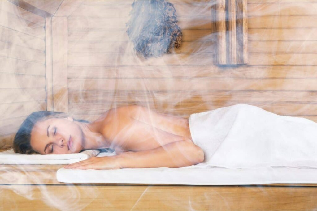 Woman relaxing in a sauna