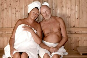 Couple relaxing in a sauna.