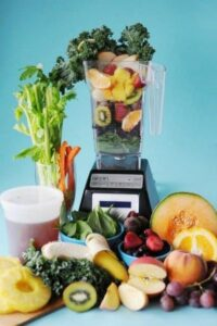 Blender with fruits and veggies
