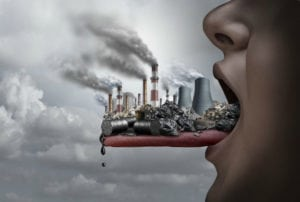 Graphic of person sticking out tongue with a small toxic city on it from
