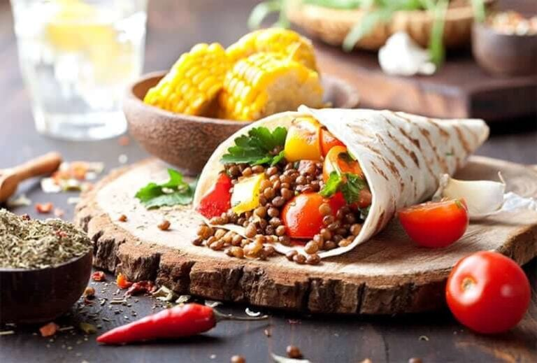 "Photo of lentil taco with tomatoes surrounding from ""Lentil Tacos"" recipe by Green Smoothie Girl"