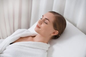 """A woman rests while wearing a heavy robe, from """"Hyperthermia Treatment: Effective, or All Hype?"""" at Green Smoothie Girl."""
