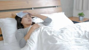 """A woman with a fever rests in her bed, from """"Hyperthermia Treatment: Effective, or All Hype?"""" at Green Smoothie Girl."""