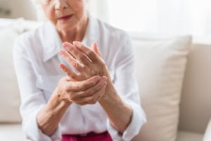 "Photograph of an elderly woman with arthritis pain in her hand, from ""Top Proven Ginger Health Benefits and My Favorite Ways to Use It"" at Green Smoothie Girl."