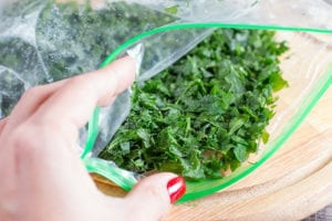 "Frozen greens in a zipped plastic bag, from ""How To Freeze Spinach and Other Leafy Greens For Later (With Shortcuts!)"" at Green Smoothie Girl."