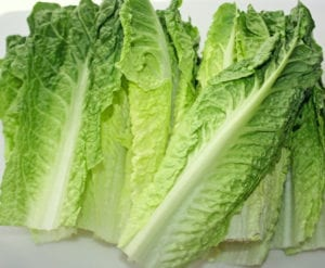 "Fresh romaine lettuce leaves on a cutting board, from ""Top 11 Greens to Use in Green Smoothies"" at Green Smoothie Girl."