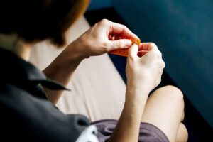 "Photograph of a woman removing a birth control pill from its package, from ""Chemotherapy and Cancer Survival"" at Green Smoothie Girl."