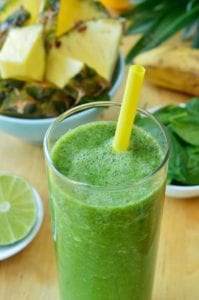 "Photo of Green spinach and pineapple smoothie on table from ""Turning Green Smoothie"" recipe by Green Smoothie Girl"