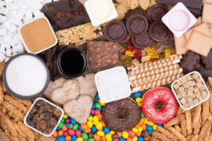 "Photograph of sugary foods including donuts, brownies, and chocolates, from ""Green Smoothies for Diabetes"" at Green Smoothie Girl."