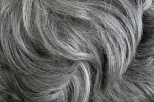 "Close-up photograph of gray hair, from ""Health Benefits of Sulfur, and Why You're Probably Deficient"" at Green Smoothie Girl"