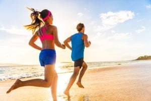 "Photograph of a man and woman in exercise gear running on the beach, from ""Health Benefits of Sulfur, and Why You're Probably Deficient"" at Green Smoothie Girl."