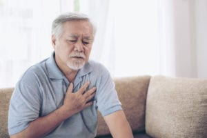 "Photograph of a senior man grasping his chest in pain, from ""Will a Fasting Diet Give You the Results You Want?"" at Green Smoothie Girl"