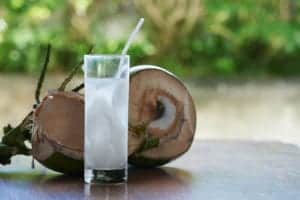"A tasty glass of coconut water, from ""These Anti Inflammatory Smoothie Recipes Target Joint Pain And More"" at Green Smoothie Girl."