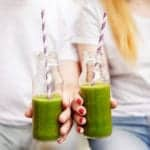 "Photo of two people holding a green smoothie, from ""Why You Should Chew Your Green Smoothies"" at GSG."