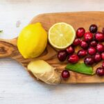 "Photo of cranberries lemons and ginger on cutting board from ""Natural Treatments for Urinary Tract Infections (UTIs)"" by Green Smoothie Girl"