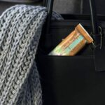 "Photo of chocolate green smoothie girl blend bar in black purse pocket from ""Why Most Nutrition Bars are Garbage -- and What to Pack in Your Purse Instead"" at Green Smoothie Girl"