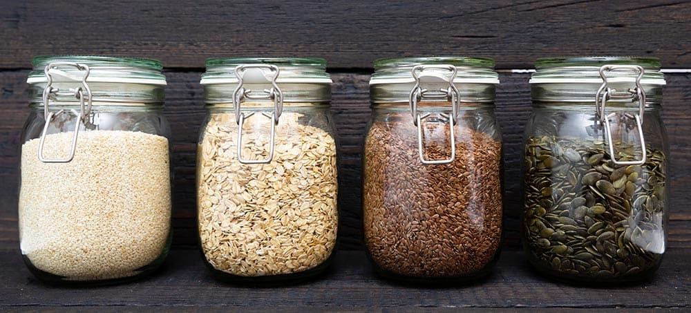 various seeds in storage jars