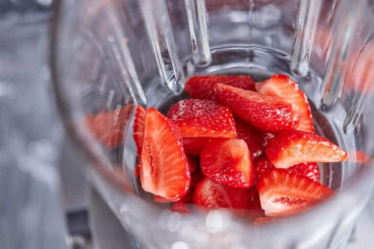 fresh strawberries in a blender