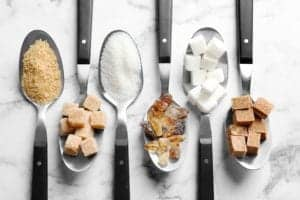 Photo of different sugars on spoons from