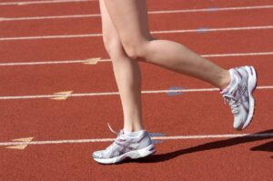 Photo of running legs on a track from