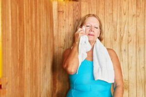 "Photo senior woman sweating in a sauna from ""Proven Infrared Sauna Therapy Benefits: A Doctor's Viewpoint"" at Green Smoothie Girl."