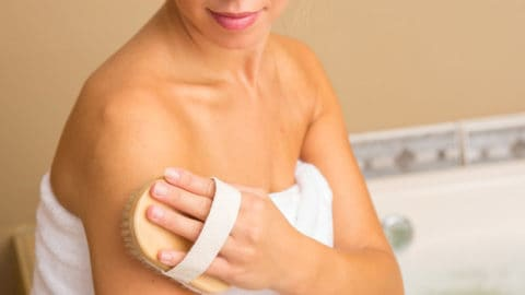 "Photo of person dry brushing, from ""Skin Brushing With A Dry Brush: Why And How, Step By Step"" at Green Smoothie Girl"