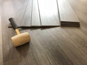 Photo vinyl flooring and application roller from