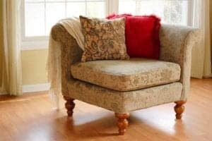 Photo of overstuffed corner chair from