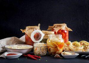Photo of Cabbage kimchi, tomatoes marinated, sauerkraut in glass jars from