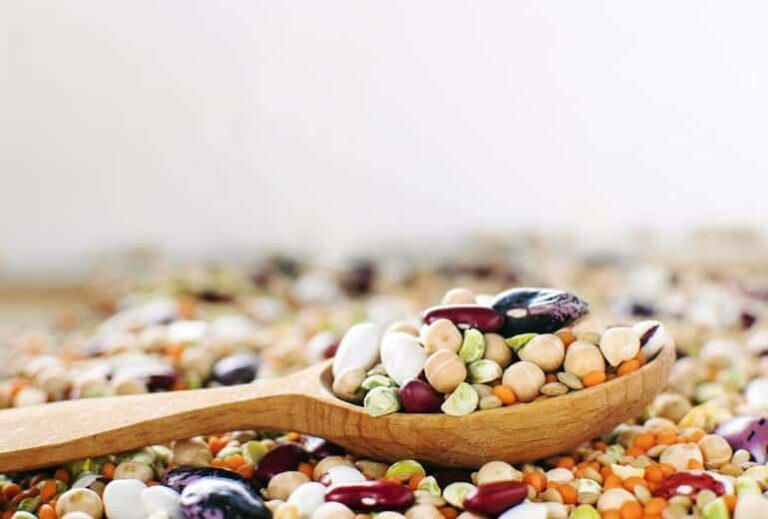 "Photo of wooden spoon holding legumes from ""How to Eat Legumes"" by Green Smoothie Girl"