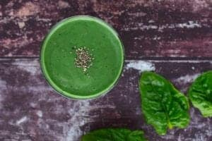 "Photo of green smoothie from above with chia seeds on top from ""Green Smoothies For Crohn's Disease: Research And Recipes"" by Green Smoothie Girl"